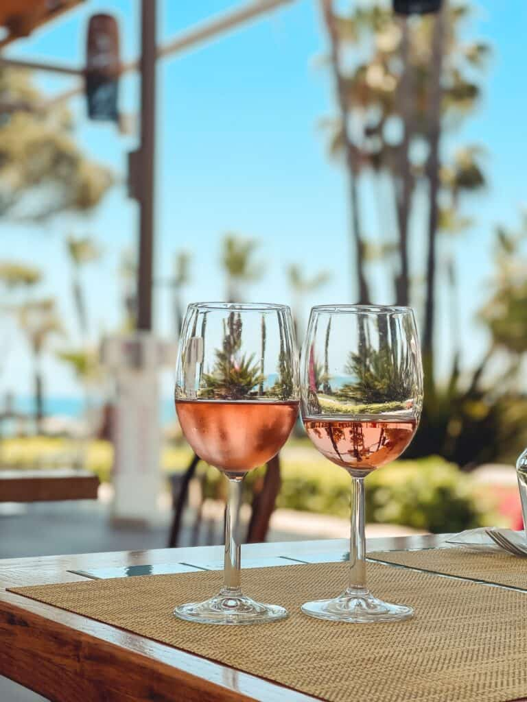 Rose wine and palms and blue sky